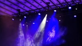 Light spots in concert - smoke and light rays. On the stage stock video