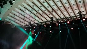 Light spots in concert - smoke and light rays. On the stage stock video footage