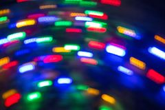 Light spots in motion. Lamps. Out of focus. Royalty Free Stock Photos