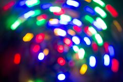Light spots in motion. Lamps. Out of focus. Royalty Free Stock Images
