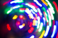 Light spots in motion. Lamps. Out of focus. Stock Images