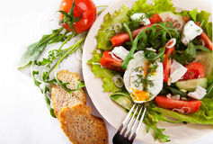 Light spring salad with poached egg Stock Image