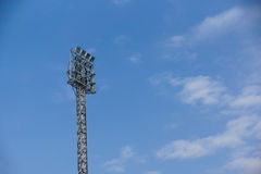 Light stadium or Sports lighting against blue sky background Stock Photos