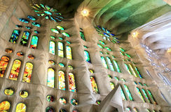 Stained-glass window of Sagrada Familia. Light through stained-glass in the church Stock Image