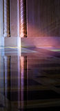 Light from stained glass windows on wall of church. Colorful light from a stained glass window in a cathedral falls on the polished marble of the church Royalty Free Stock Photography