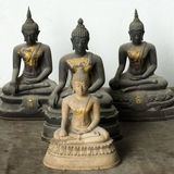 Light Stone Buddha and Three Dark statue Stock Photos