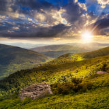 Light on stone mountain slope with forest at sunset Royalty Free Stock Photos