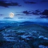 Light on stone mountain slope at night Stock Images