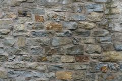 Stone wall of hewn stone in the medieval style. royalty free stock photo