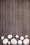 Light stones on wooden ebony background Stock Photos
