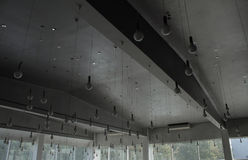 Light store. Round lamps on wires hanging from the ceiling Stock Images
