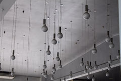 Light store. Round lamps on wires hanging from the ceiling Royalty Free Stock Photo