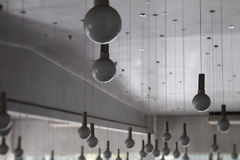 Light store. Round lamps on wires hanging from the ceiling Royalty Free Stock Photography