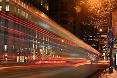 Light streaking from city bus in Chicago. Night time city shot with streaking lights from passing bus Stock Photos