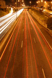 Light streaks on a city highway. City highway overpass with multiple light streaks from cars passing by Stock Photo