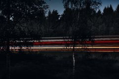 Light streaks on highway at night Stock Image