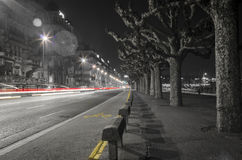 Light streaks in the night of Geneva Royalty Free Stock Images