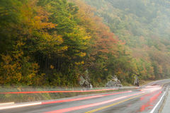 Light streaks passing vehicles Stock Images