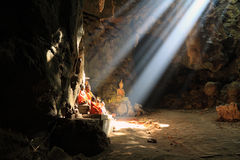 Light streams down from hole. Khao Luang Cave,Thailand Royalty Free Stock Photos