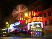 Light streams at the Moulin Rouge at Night, Montmartre, Paris Stock Image