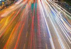 light streams from ongoing traffic in business district road Stock Photography