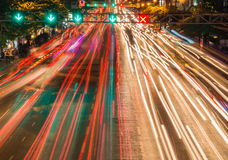 light streams from ongoing traffic in business district road Royalty Free Stock Images