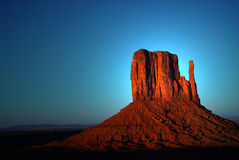 Light striking a rock formation in Monument Valley Stock Photos