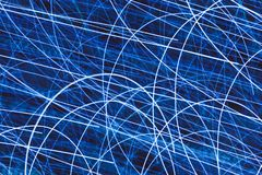 Light striped trails with chaotic motion. Background Stock Photo