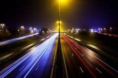 Light stripes of motorway. During the evening on a busy motorway with slow shutter speed you get light stripes royalty free stock image