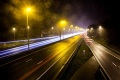 Light stripes of motorway. During the evening on a busy motorway with slow shutter speed you get light stripes royalty free stock images