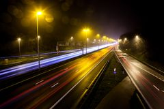 Light stripes of motorway. During the evening on a busy motorway with slow shutter speed you get light stripes stock photo
