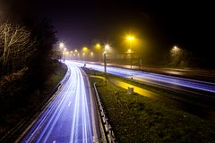Light stripes of motorway. During the evening on a busy motorway with slow shutter speed you get light stripes stock image