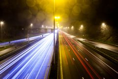 Light stripes of motorway. During the evening on a busy motorway with slow shutter speed you get light stripes stock photography