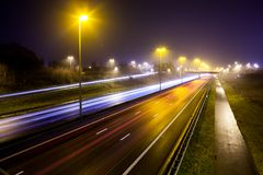 Light stripes of motorway. During the evening on a busy motorway with slow shutter speed you get light stripes stock images