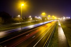 Light stripes of motorway. During the evening on a busy motorway with slow shutter speed you get light stripes royalty free stock photo