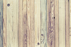 Light stylized wood background. Light stylized decorative wood background from variety of narrow strips textured and with knots Royalty Free Stock Images