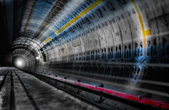 Light in Subway Tunnel. Hope, trust or danger concept represented by subway tunnel with ray of light at the end Royalty Free Stock Photo