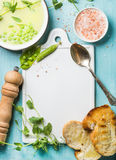 Light summer green pea cream soup in bowl with sprouts, bread toasts and spices. Top view, copy space Royalty Free Stock Photos