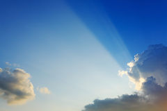 Light of sunbeams through clouds, light rays on dramatic sunset Stock Photography