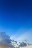 Light of sunbeams through clouds, light rays on dramatic sunset Stock Photos