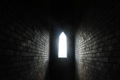 Light of sunshine stream through block wall window Stock Photos