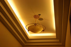 Light suspended from ceiling. Modern light fixture suspended from ceiling royalty free stock photos