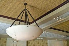 Light suspended from ceiling. Modern light fixture suspended from ceiling stock photo