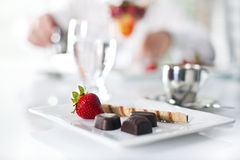 Light sweet dessert. Elegant chocolate dessert at the restaurant strawberry,cookies,coffee and chocolate Stock Image