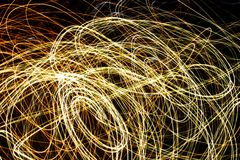 Light Swirls. Light trails caused by long exposure and movement of the camera on outside electric lighting Royalty Free Stock Image