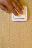 Light switch. Turning light switch off. Hand royalty free stock images