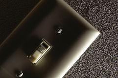 Light Switch. Side lit electrical switch plate Stock Photos