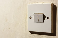 Light switch. Detail of a domestic light switch Stock Photography