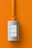 Light Switch. On Orange Wall stock images