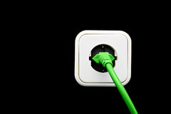 Light switch as green energy concept. On black background Stock Photos